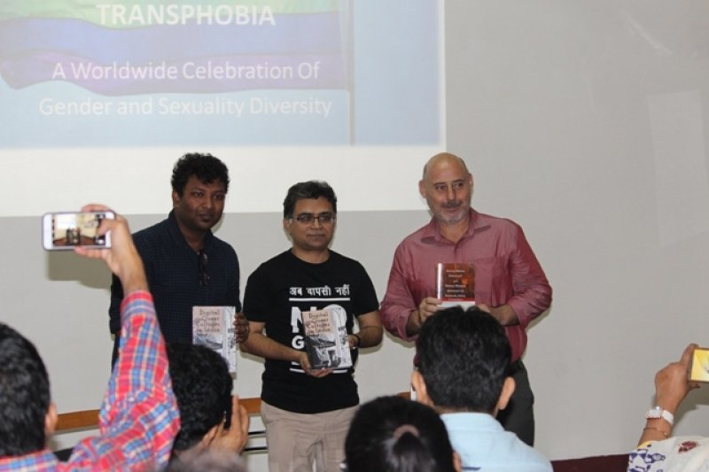 This first (main) photograph shows the book launch ceremony during the event 'Books, Films and IDAHOBIT 2017' organized at the Alliance Francaise du Bengale Park Street centre in Kolkata on May 4, 2017. Dr. Rohit K. Dasgupta, Pawan Dhall and Stephane Amalir (standing from left to right) can be seen holding the two books launched, smiling and facing the cameras in the audience. The books launched were 'Digital Queer Cultures in India – Politics, Intimacies and Belonging' and 'Social Media, Sexuality and Sexual Health Advocacy in Kolkata, India'. The first was authored by Dr. Rohit K. Dasgupta, Lecturer in Media and Creative Industries at Loughborough University, UK. The second was co-authored by Dr. Rohit K. Dasgupta and Pawan Dhall, queer activist and Founding Trustee, Varta Trust. Stephane Amalir is Director, Alliance Francaise du Bengale. In the background is a screen projection of a graphic highlighting the International Day Against Homophobia, Biphobia and Transphobia. Photo credit: Arunabha Hazra