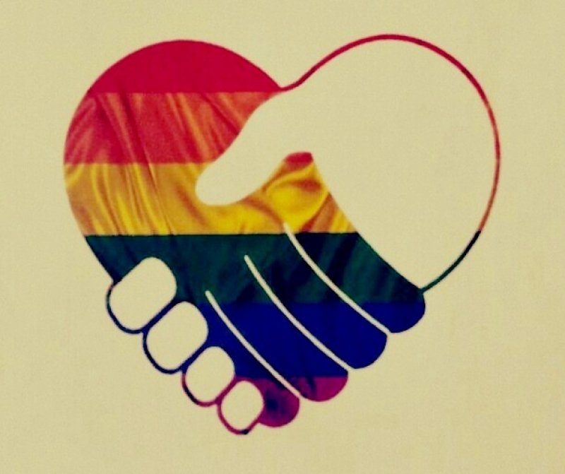 This artwork image is borrowed from the cover page of a summary of the Supreme Court's Section 377 verdict – the summary titled 'Right to Love – Navtej Singh Johar V. Union of India: A Transformative Constitution and the Rights of LGBT Persons' was published by Alternative Law Forum, Bangalore with inputs from queer activists across India in September 2018. The image shows a graphic of two hands held together in a friendly handshake grip. It could also be seen as any two lovers holding hands. One of the hands is coloured in the queer pride rainbow flag shades, while the other is white in colour. The outline of the two hands together is shaped like a love sign. In a sense, the graphic colours could also be interpreted as a friendly handshake between a queer person (symbolized by the rainbow coloured hand) and the State (symbolized by the white hand). The graphic is placed on a yellowish background. Artwork credit: Alternative Law Forum