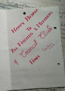 "This is a photograph of the inside of the same greeting card as shown in the main illustration of this article. The card is lying open on a file of letters received by Counsel Club. The sender of the card has written out the following message in red ink and bold lettering inside the card: ""Happy Bijoya to All Friends and Members of Counsel Club – From Santanu, 11.10.98"". A few letters can be seen filed in the background, but the contents are not quite legible. Photo credit: Pawan Dhall"