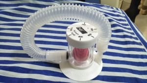 This indoor photograph is a close-up shot of an incentive spirometer placed on the author's bed in the hospital where he was admitted for COVID-19 treatment. This instrument is used for a breathing exercise that helps clear the lungs that become congested because of the coronavirus infection that causes COVID-19. There are several varieties of incentive spirometers available in the market. Photo credit: Pawan Dhall